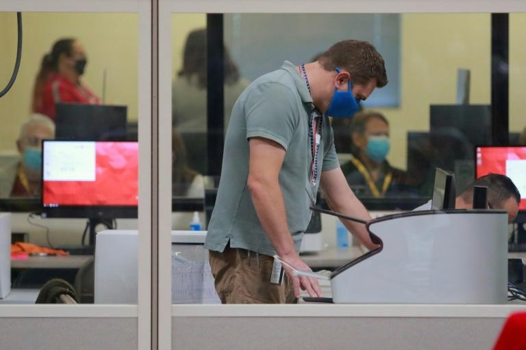 A worker handles official ballots at the Clark County Election Department on November 5, 2020, in North Las Vegas