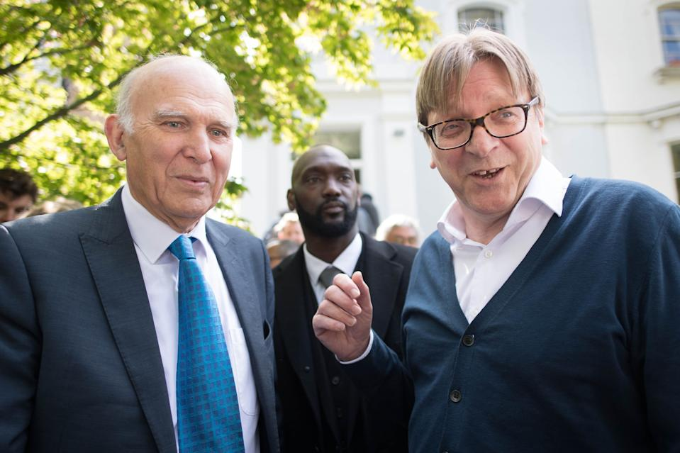 Guy Verhofstadt (right), joins Lib Dem leader Sir Vince Cable in London during their EU election campaign on Friday (PA)