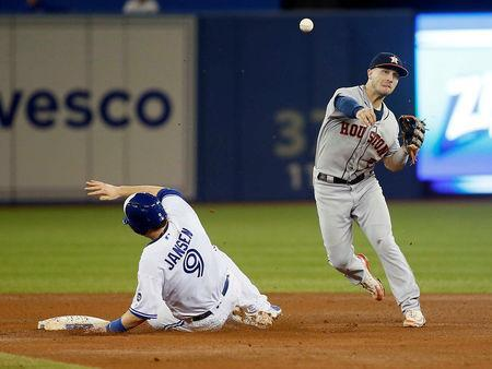 Sep 25, 2018; Toronto, Ontario, CAN; Houston Astros shortstop Alex Bregman (2) turns a double play on Toronto Blue Jays catcher Danny Jansen (9) and Toronto Blue Jays secnd baseman Richard Urena (not pictured) in the fifth inning at Rogers Centre. Mandatory Credit: John E. Sokolowski-USA TODAY Sports