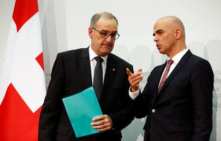 Swiss Defence Minister Guy Parmelin (L) and Interior Minister Alain Berset attend a news conference in Bern September 25, 2016. REUTERS/Ruben Sprich