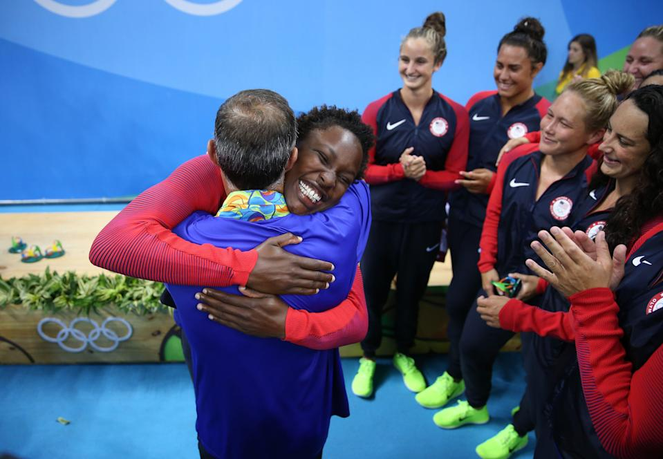 Ashleigh Johnson embraces coach Adam Krikorian in the women's water polo medal ceremony at Olympic Aquatics Stadium during the Rio 2016 Summer Olympic Games.