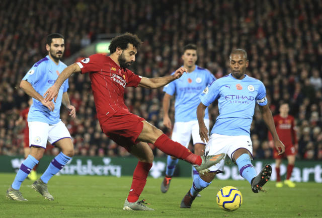 Liverpool's Mohamed Salah makes an attempt to score during the English Premier League soccer match between Liverpool and Manchester City at Anfield stadium in Liverpool, England, Sunday, Nov. 10, 2019. (AP Photo/Jon Super)