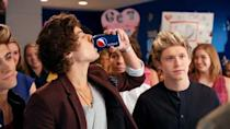 "<p>Harry Styles and Drew Brees debate who deserves to get Pepsi first in this <a href=""https://www.youtube.com/watch?v=Sfy8UYRhmpA"" rel=""nofollow noopener"" target=""_blank"" data-ylk=""slk:2012 commercial"" class=""link rapid-noclick-resp"">2012 commercial</a>: someone with a platinum album or a person who's won a Super Bowl. The argument is resolved when a 1D member suggests that Brees can join the band <em>if </em>he lets Harry have the first Pepsi. Compromise!</p>"