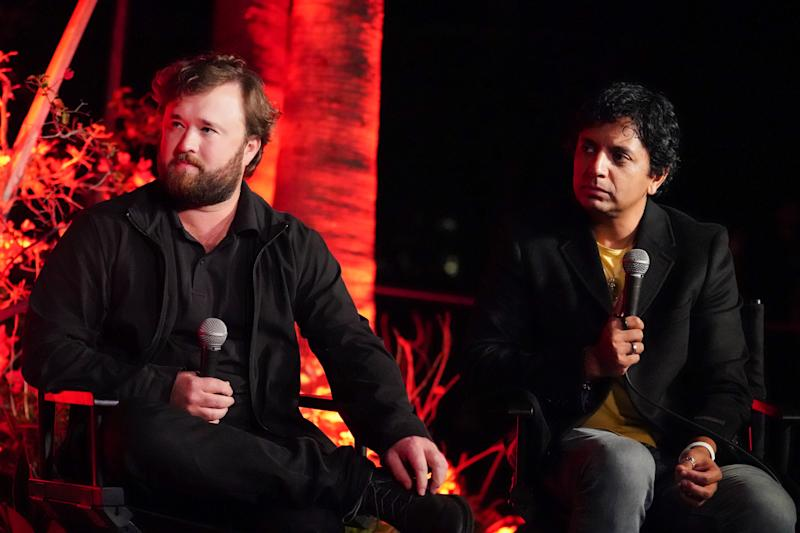 "HOLLYWOOD, CALIFORNIA - OCTOBER 19: ((L-R) Haley Joel Osment and M. Night Shyamalan participate in the Cinespia 20th anniversary screening of ""The Sixth Sense"" presented by Amazon Studios at Hollywood Forever on October 19, 2019 in Hollywood, California. (Photo by Rachel Luna/Getty Images)"