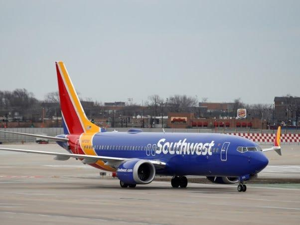 FILE PHOTO: A Southwest Airlines Co. Boeing 737 MAX 8 aircraft taxis after landing at Midway International Airport in Chicago, Illinois, U.S., March 13, 2019. REUTERS/Kamil Kraczynski
