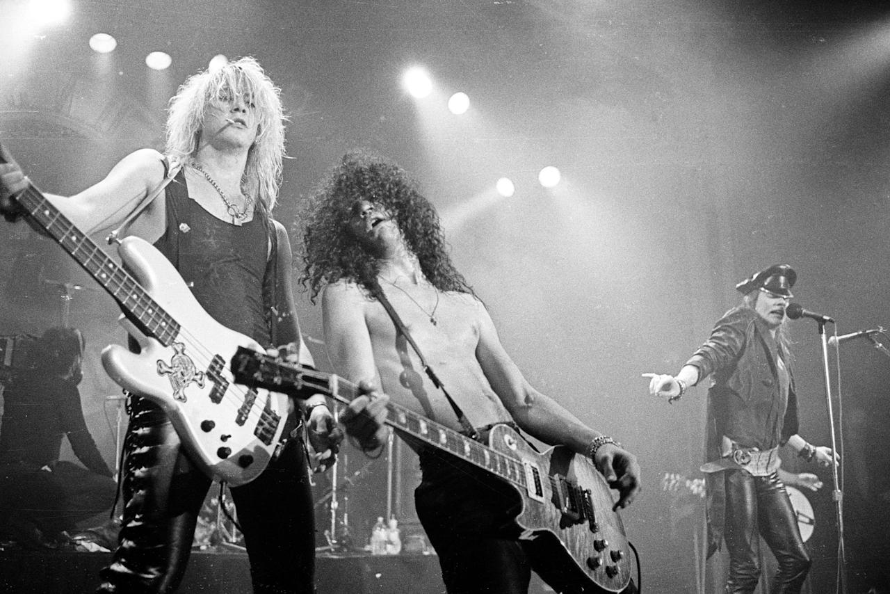 Duff McKagan, Slash and Axl Rose of Guns 'n' Roses perform in concert at the Ritz on February 2, 1988 in New York City.  (Photo by Larry Busacca/WireImage)