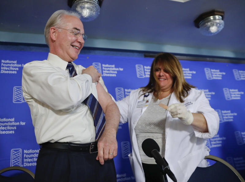 Health and Human Services Secretary Tom Price, left, is given a band-aid after a flu vaccination from Sharon Walsh-Bonadies, RN., right, during a news conference recommending everyone age six months an older be vaccinated against influenza each year, Thursday, Sept. 28, 2017 in Washington. (AP Photo/Pablo Martinez Monsivais)