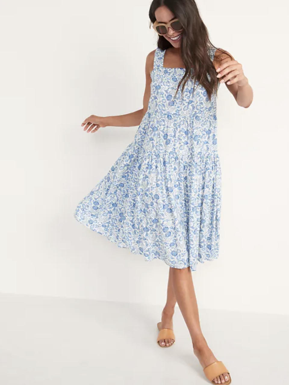 Sleeveless Smocked Floral Midi Swing Dress in Blue Floral (Photo via Old Navy)