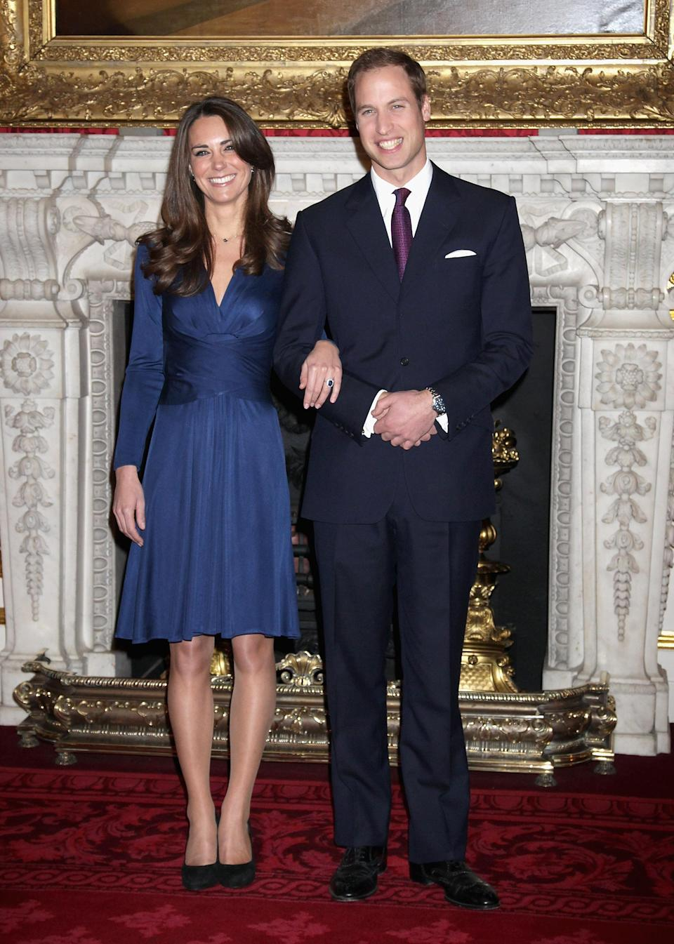 <p>On November 16, 2010 the Duke and Duchess of Cambridge announced their engagement to the world. For the couple's photocall, Kate opted for a suitably royal blue dress by Issa. <em>[Photo: Getty]</em> </p>