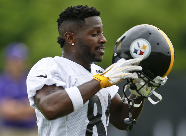 Pittsburgh Steelers wide receiver Antonio Brown (84) puts his helmet on during NFL football practice, Tuesday, May 22, 2018, in Pittsburgh. (AP Photo/Keith Srakocic)