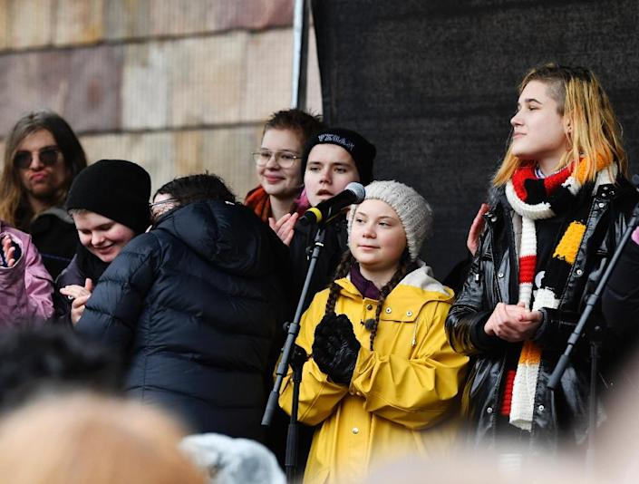 """""""We are living through an existential crisis that has been ignored for decades,"""" says 16-year-old Swedish activist Greta Thunberg, wearing yellow, who has been nominated for a Nobel Peace Prize (AFP Photo/Henrik MONTGOMERY)"""