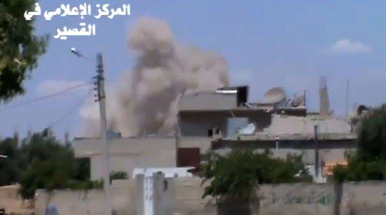 A image grab taken from a Youtube video on May 22, 2013 shows smoke billowing from Qusayr, in Syria's Homs province