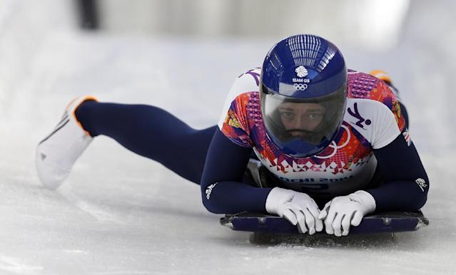 Elizabeth Yarnold of Great Britain brakes in the finish area after her first run during the women's skeleton competition at the 2014 Winter Olympics, Thursday, Feb. 13, 2014, in Krasnaya Polyana, Russia. (AP Photo/Natacha Pisarenko)