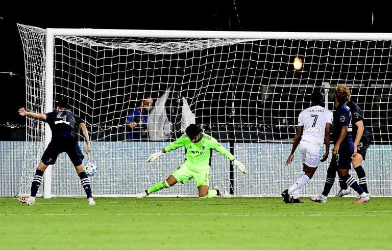 Kevin Molino of Minnesota United scores the game-winning goal in a 2-1 victory over Sporting Kansas City in the MLS Is Back tournament in Orlando, Florida