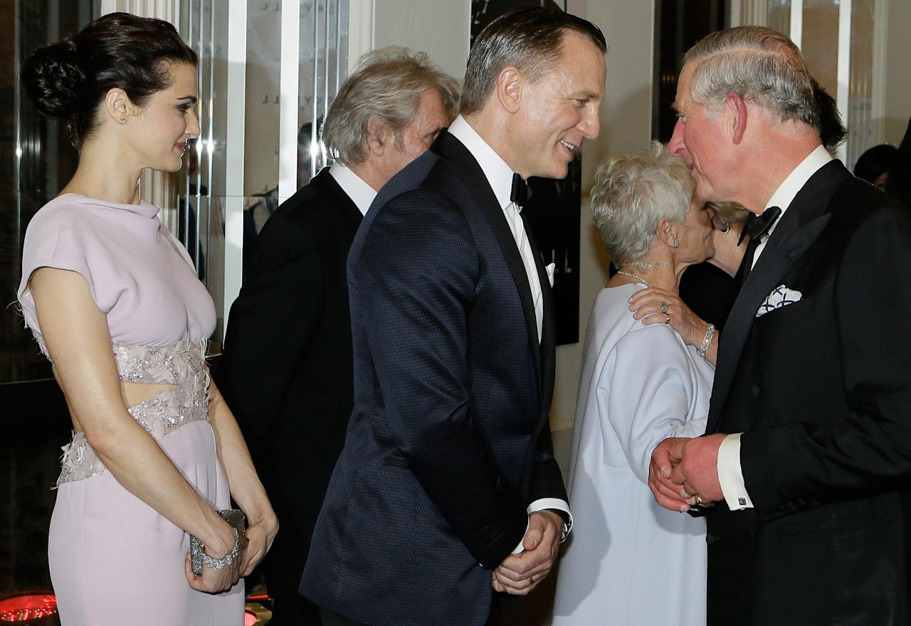 "LONDON, UNITED KINGDOM - OCTOBER 23:  Prince Charles, Prince of Wales (R) meets James Bond actor Daniel Craig (C) and his wife Rachel Weisz as they arrive for the Royal World Premiere of the James Bond film ""Skyfall"" at the Royal Albert Hall on October 23, 2012 in London, England.  (Photo by Kirsty Wigglesworth - WPA Pool/Getty Images)"