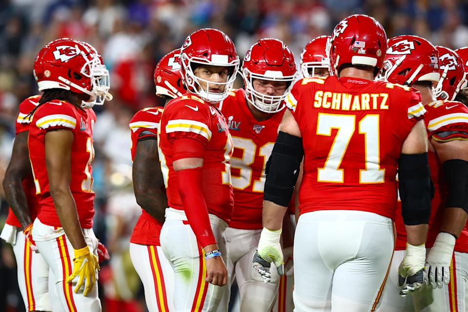 Feb 2, 2020; Miami Gardens, Florida, USA; Kansas City Chiefs quarterback Patrick Mahomes (15) looks to the sidelines while in the huddle during the first quarter against the San Francisco 49ers in Super Bowl LIV at Hard Rock Stadium. Mandatory Credit: Matthew Emmons-USA TODAY Sports