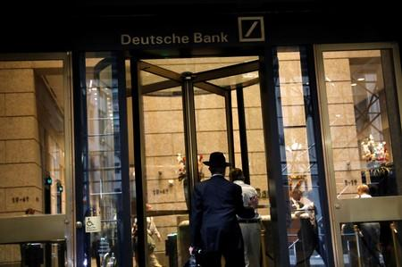 A man enters the lobby of the U.S. headquarters of Deutsche Bank in New York City