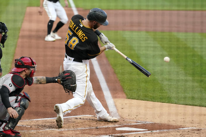 Pittsburgh Pirates' Jacob Stallings singles off Cincinnati Reds starting pitcher Wade Miley, driving in a run during the first inning of a baseball game in Pittsburgh, Tuesday, Sept. 14, 2021. (AP Photo/Gene J. Puskar)