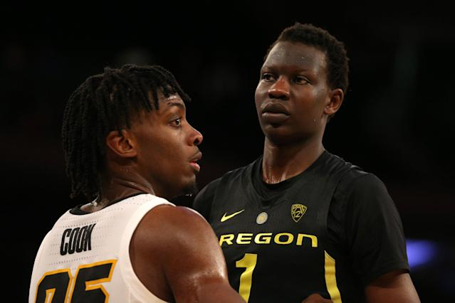 Iowa Hawkeyes forward Tyler Cook (25) defends Oregon Ducks center Bol Bol (1) on an in-bounds play during the second half at Madison Square Garden. (Brad Penner/USA Today Sports)