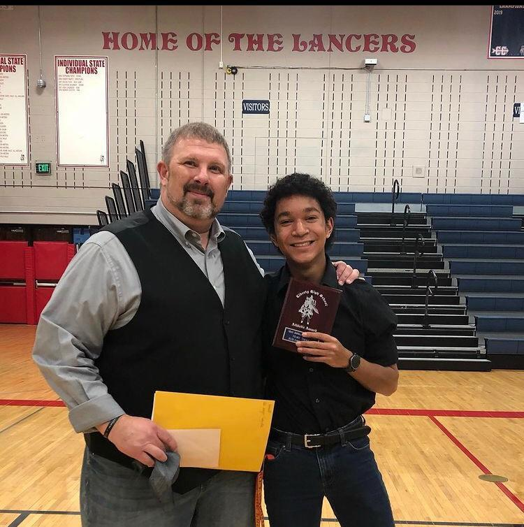 Marc Small and his football coach. (Photo courtesy of Marc Small)