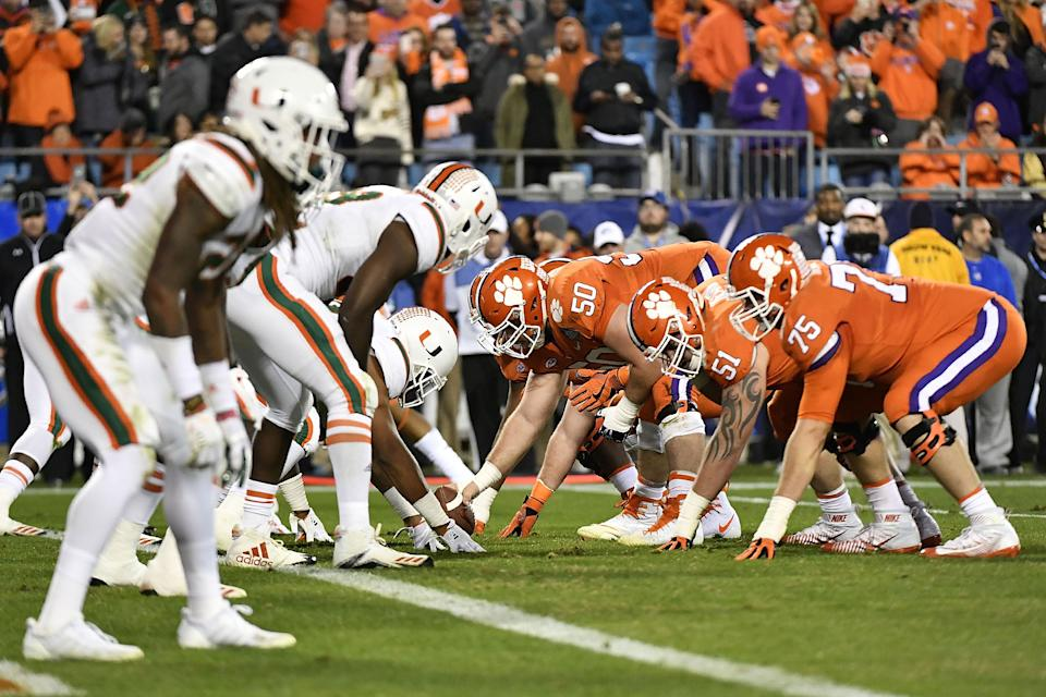 The Clemson Tigers offense lines up against the Miami Hurricanes during an ACC championship game. (Mike Comer/Getty Images)
