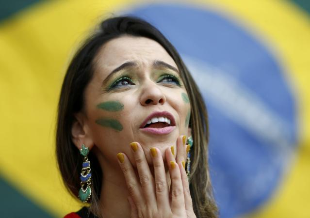 A Brazil fan waits for the 2014 World Cup Group A soccer match between Cameroon and Brazil at the Brasilia national stadium in Brasilia June 23, 2014. REUTERS/Dominic Ebenbichler (BRAZIL - Tags: SOCCER SPORT WORLD CUP)