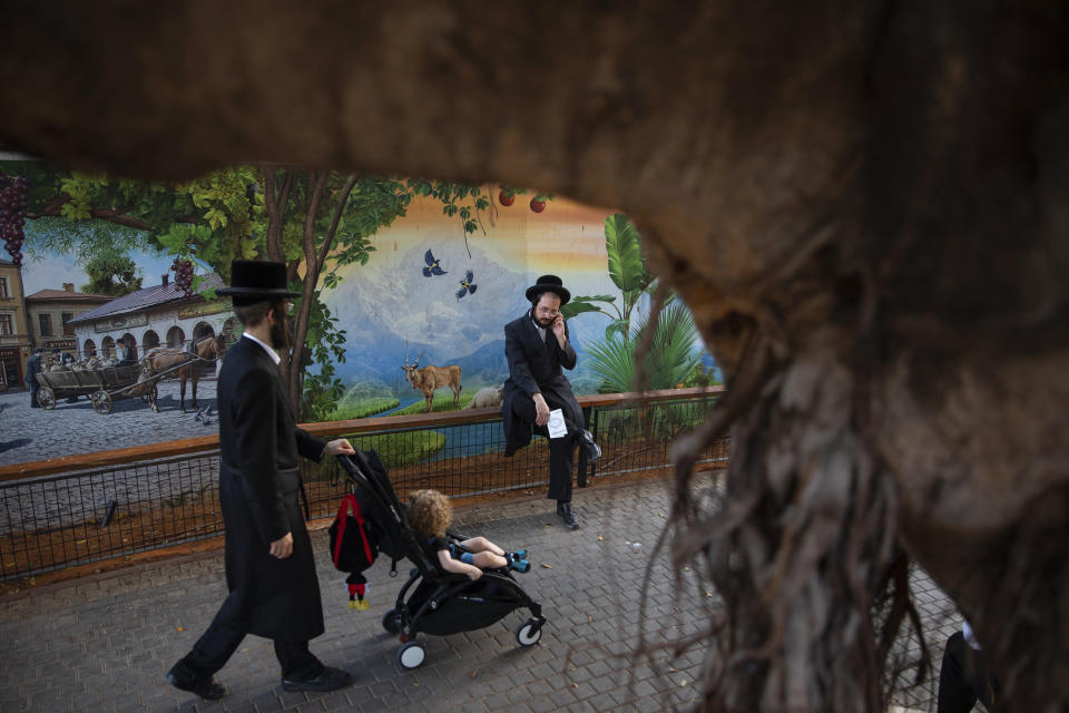 Ultra-Orthodox Jews gather for the Tashlich ceremony, at a zoo in the ultra-Orthodox Israeli town of Bnei Brak, Tuesday, Sept. 14, 2021. Tashlich, which means 'to cast away' in Hebrew, is the practice by which Jews go to a large flowing body of water and symbolically 'throw away' their sins by throwing a piece of bread, or similar food, into the water before the Jewish holiday of Yom Kippur, the holiest day in the Jewish year which starts at sundown Wednesday. (AP Photo/Oded Balilty)