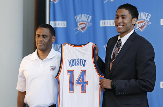 Oklahoma City Thunder forward Josh Huestis, right, and Troy Weaver, left, Thunder vice president and assistant general manager, hold a basketball jersey as Huestis is introduced during a news conference in Oklahoma City, Friday, June 27, 2014. (AP Photo/Sue Ogrocki)