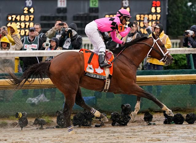 Maximum Security's owners are still considering legal options after the historic disqualification at the Kentucky Derby last week, and their jockey has hired an attorney. (AP/Morry Gash)
