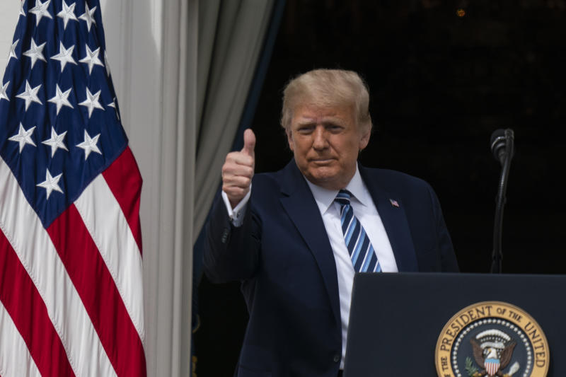 Donald Trump gives thumbs up as he departs after speaking from the Blue Room Balcony of the White House to a crowd of supporters, Saturday, Oct. 10, 2020, in Washington.