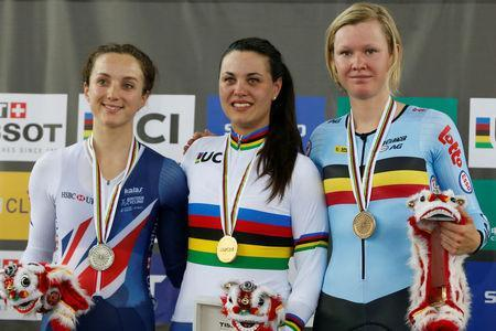 Cycling - UCI Track World Championships - Women's Scratch Race, Final - Hong Kong, China - 12/4/17 - Britain's Elinor Barker, Italy's Rachele Barbieri and Belgium's Jolien D'Hoore celebrate with their medals on the podium. REUTERS/Bobby Yip