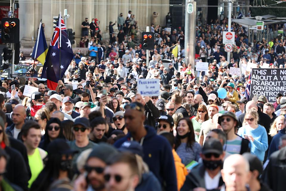 Thousands of people gathered in Melbourne's CBD to protect lockdown restrictions despite denouncement from police and health officials. Source: Getty