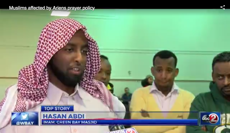An Imam speaks to a local news agency about the dispute over prayer at Ariens. Screenshot/WBAY.com