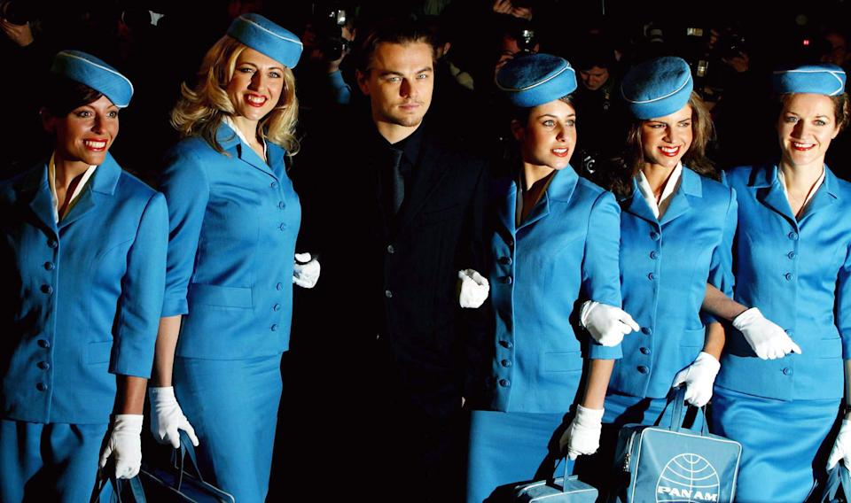 US actor Leonardo DiCaprio, centre, stands with models posing as Pan Am air hostesses at the UK premiere of the film 'Catch Me If You Can' in London on 27 January 2003. DiCaprio plays a criminal mastermind and compulsive liar in the film. Photo: Reuters