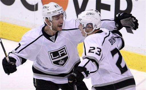 Los Angeles Kings right wing Dustin Brown (23) celebrates his third goal of the night against the Vancouver Canucks with teammate Alec Martinez (27) during third period of game two of first round NHL Stanley Cup playoff hockey action at Rogers Arena in Vancouver, British Columbia, Friday, April, 13, 2012. (AP Photo/The Canadian Press, Jonathan Hayward)