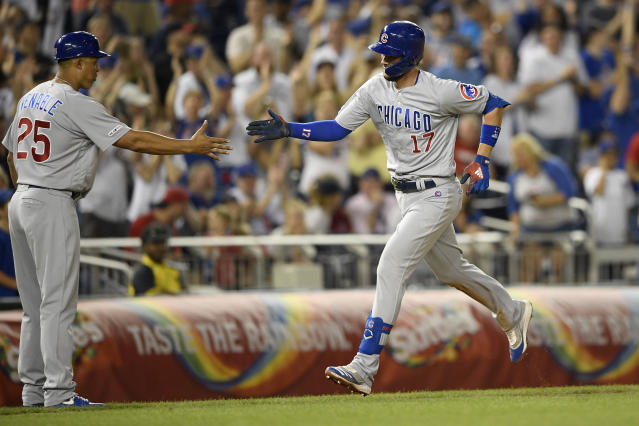 Chicago Cubs' Kris Bryant (17) is greeted by third base coach Will Venable (25) after hitting a home run during the eighth inning of a baseball game against the Washington Nationals, Friday, May 17, 2019, in Washington. (AP Photo/Nick Wass)