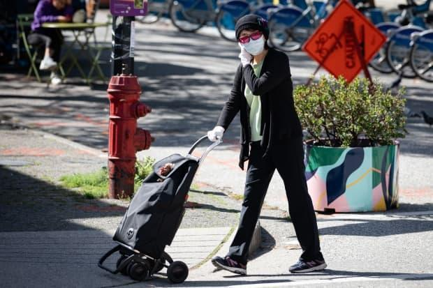 A pedestrian in downtown Vancouver on Sept. 7. (Maggie MacPherson/CBC News - image credit)