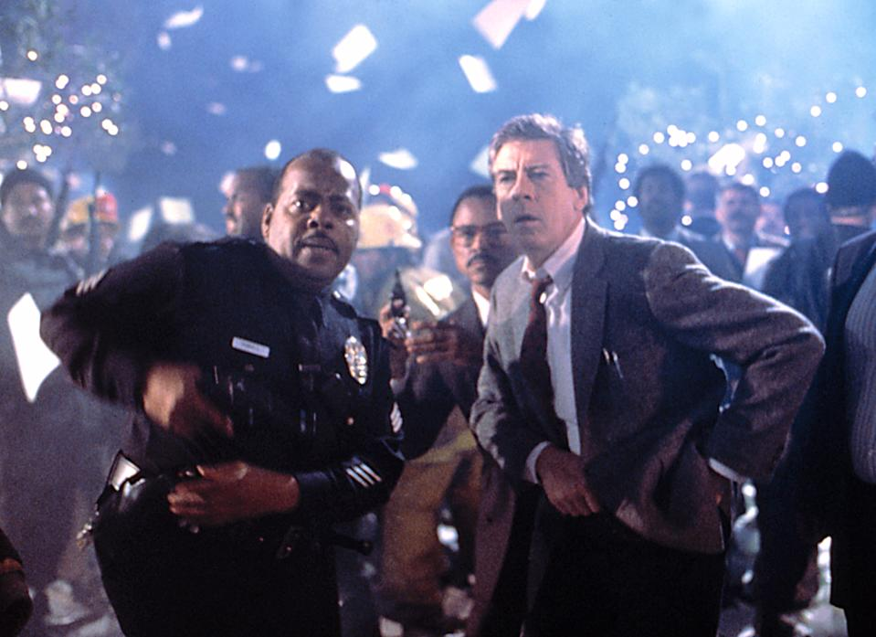 Reginald VelJohnson and Paul Gleason in the climactic scene of 'Die Hard,' where paper falls from the skyscraper like snowflakes (Photo: 20th Century Fox Film Corp/Courtesy Everett Collection)