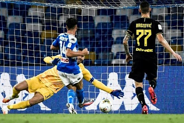 Dries Mertens slots home his 122nd Napoli goal against Inter Milan to become the club's all-time top goalscorer (AFP Photo/Filippo MONTEFORTE)