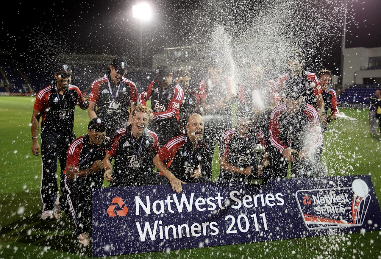 CARDIFF, WALES - SEPTEMBER 16:  Alastair Cook of England and his team mates celebrate with champagne and the trophy following their series victory at the end of the 5th Natwest One Day International Series match between England and India at the Swalec Stadium on September 16, 2011 in Cardiff, Wales.  (Photo by Michael Steele/Getty Images)