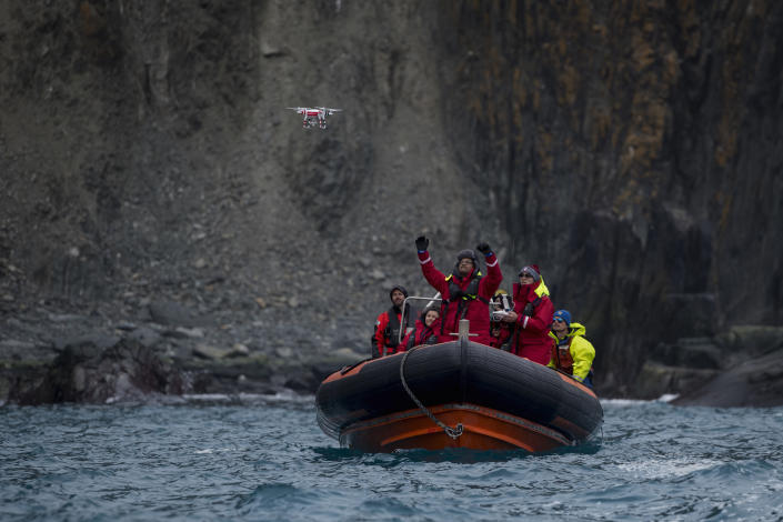 Yang Liu and Vikrant Shah, from North Eastern University, launch a drone from a Greenpeace inflatable. They will later use machine learning to do an automated count of penguin colonies on Elephant Island. The drone counts are later compared to the manual counts done by another team of scientists. | Christian Åslund —Greenpeace and TIME