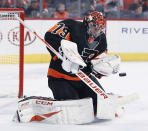 Philadelphia Flyers' Carter Hart stops a shot on goal during the first period of an NHL hockey game against the New York Rangers, Monday, Dec. 23, 2019, in Philadelphia. (AP Photo/Tom Mihalek)