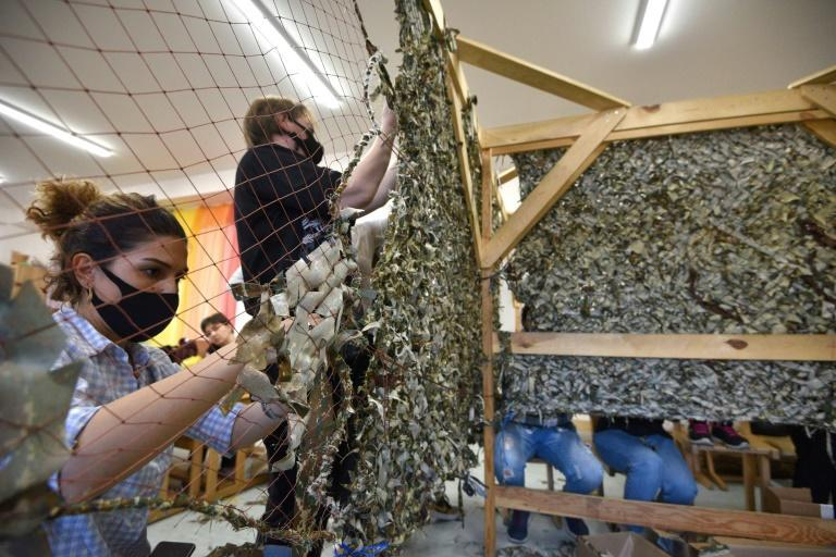Armenian women in Yerevan make camouflage netting tobe sent to a frontline in Karabakh