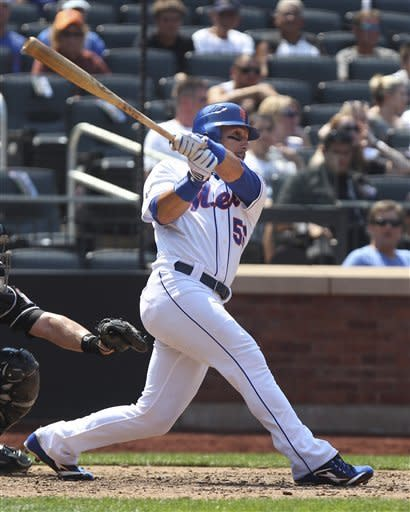 New York Mets' Andres Torres triples during the eighth inning of the baseball game against the Miami Marlins Thursday, Aug. 9, 2012 at Citi Field in New York. The Mets beat the Marlins 6-1. (AP Photo/Seth Wenig)