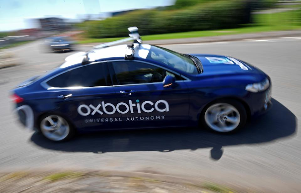 A passenger vehicle is seen traveling autonomously using Oxbotica software during a trial on public roads in Oxford, Britain, June 27, 2019. Picture taken June 27, 2019. REUTERS/Toby Melville