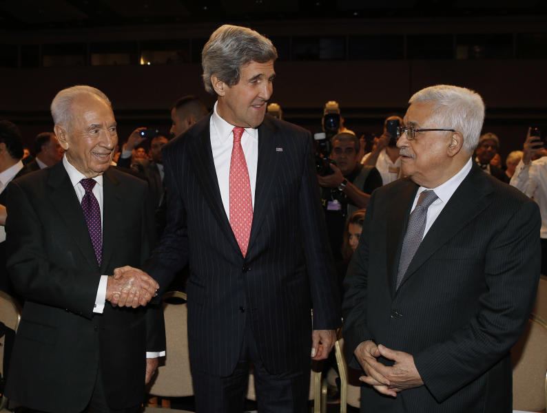 U.S. Secretary of State John Kerry, center, Israeli President Shimon Peres, right, and Palestinian President Mahmoud Abbas share words the World Economic Forum on the Middle East and North Africa at the King Hussein Convention Centre at the Dead Sea in Jordan Sunday May 26, 2013. (AP Photo/Pool, Jim Young)
