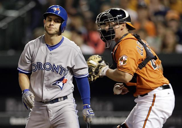 Toronto Blue Jays' Jonathan Diaz walks off the field in front of Baltimore Orioles catcher Steve Clevenger after striking out in the 10th inning of a baseball game, Saturday, April 12, 2014, in Baltimore. Baltimore won 2-1 in twelve innings. (AP Photo/Patrick Semansky)