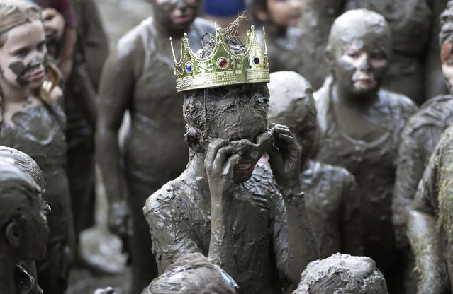 <p>Mackenna Kofahl, 12, removes her goggles after being crowned 2017 Queen of Mud Day at the Nankin Mills Park, July 11, 2017 in Westland, Mich. (Photo: Carlos Osorio/AP) </p>