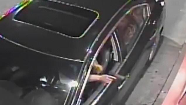 Security footage shows the woman pointing a gun while in the drive-thru. (Photo: WSB-TV)