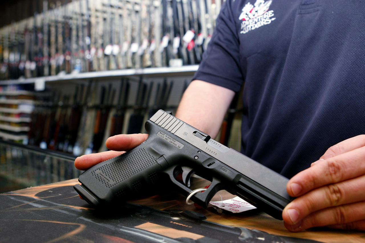 "A Glock handgun available in a raffle promotion is shown at Adventures Outdoors in Smyrna, Georgia, October 25, 2012. The store has promoted the raffle on billboards as a ""Vote. Win a rifle."" but owner Jay Wallace has stated that all Georgia residents are eligible to enter.  REUTERS/Tami Chappell (UNITED STATES - Tags: POLITICS ELECTIONS SOCIETY)"